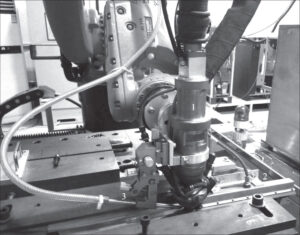 Appearance of the head for laser-microplasma welding in hand robot KUKA KR30HA: 1 - integrated plasmatron; 2 - seam protection system; 3 - mouthpiece for feeding filler wire